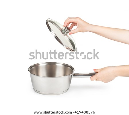 Womens Hands opening kitchen pot lid over white background - stock photo