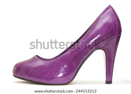 Womens purple patent high heels on white background with red sole