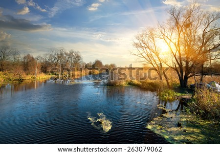Wonderful autumn on a river at sunrise - stock photo