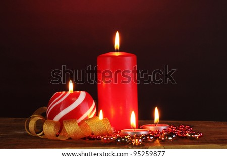 Wonderful candles on wooden table on dark background