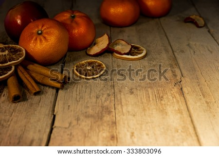 wonderful christmas background with fruits and decoration on a table - stock photo