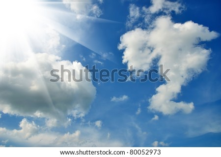 Wonderful clouds and sun against blue sky - stock photo