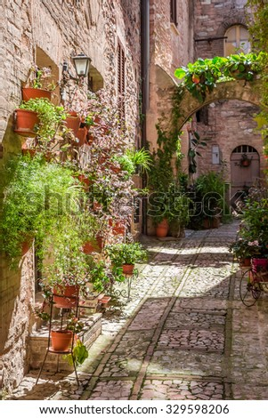 Wonderful decorated porch in small town in Italy in sunny day, Umbria - stock photo