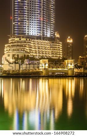 Wonderful Dubai skyscrapers and fountain at night - stock photo
