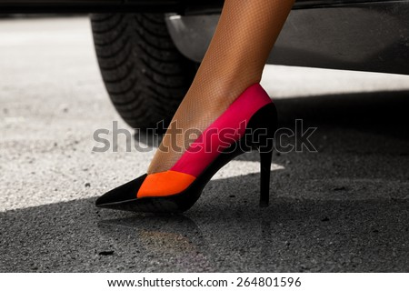 Wonderful female leg in sexy high heels outdoors - stock photo