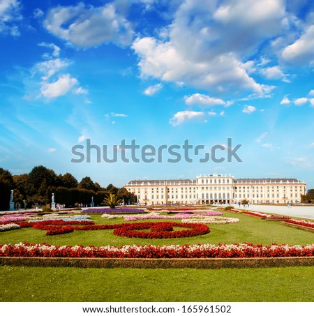 Wonderful gardens of Schonbrunn Castle in Vienna. Summer colors with sunset sky. - stock photo