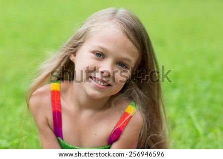 Wonderful girl seven years for a walk in the park. - stock photo