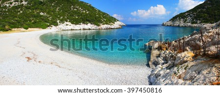 Wonderful Glisteri bay beach with crystal clear water and small wooden port, Skopelos island, Greece - stock photo
