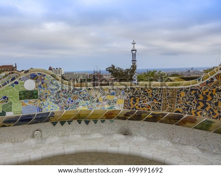 Wonderful mosaic art on the benches at Park Guell in Barcelona - BARCELONA / SPAIN - OCTOBER 5, 2016