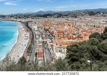 Wonderful panoramic view of Nice with colorful historical houses and sea from Cimiez hill. Nice - luxury resort of Cote d'Azur, France. - stock photo