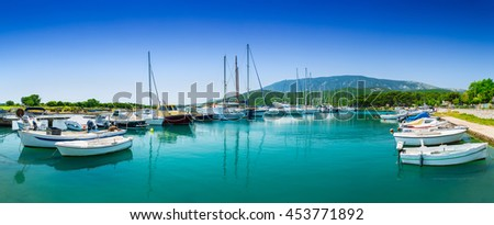 Wonderful romantic old town at Adriatic sea. Boats and yachts in harbor at magical summer. Osor. Cres island. Croatia. Europe. - stock photo