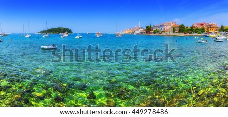 Wonderful romantic old town at Adriatic sea. Boats and yachts in harbor crystal clear turquoise water at magical summer. Rovinj. Istria. Croatia. Europe.