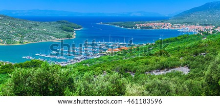 Wonderful romantic summer afternoon landscape panorama coastline Adriatic sea. Boats and yachts in harbor at magical clear transparent turquoise water. Cres island. Croatia. Europe.