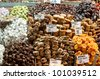 Wonderful selection of Turkish sweets, dried fruits and nuts in a stall in the Istanbul spice market.  Two of the labels read Viagra and enerji. Includes  apricots, turkish delight, baklava and figs. - stock photo