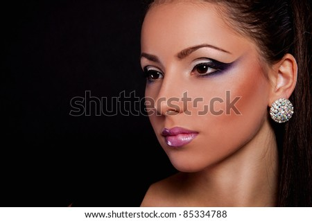 wonderful sexy young woman with pink lips on black background