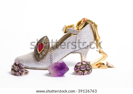 Wonderful slipper with jewels on white background - stock photo