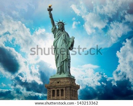 Wonderful upward view of Statue of Liberty, symbol of New York City. - stock photo