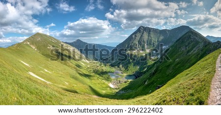 Wonderful valley in summer mountains with lakes and surrounding peaks - West Tatras, Slovakia, Europe - stock photo