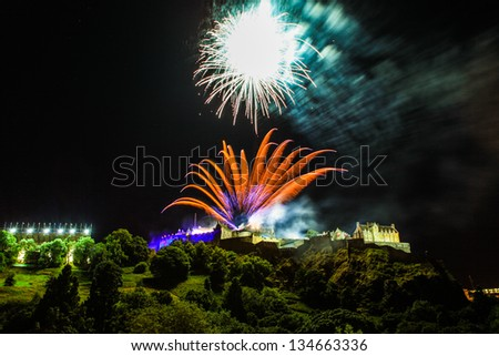 Wonderful view of Edinburgh castle at night with fireworks. - stock photo