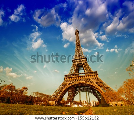 Wonderful view of Eiffel Tower in Paris. La Tour Eiffel with sky and meadows. - stock photo