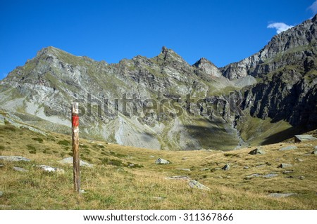 Wonderful view of the swiss mountains with indication pole
