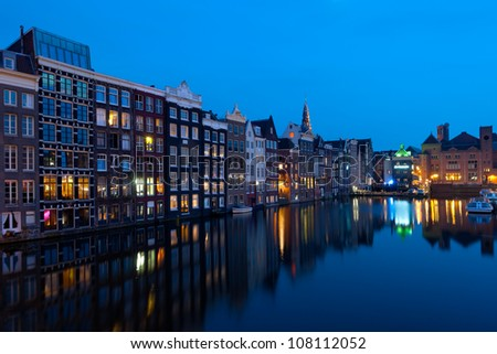 Wonderful view on  houses of Amsterdam in night. GPS information is in the file. - stock photo