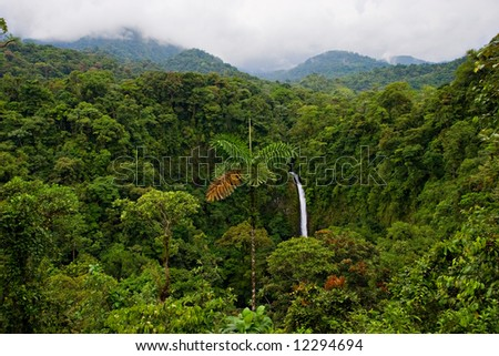 Wonderful view over Costa Rican rain forest. La Fortuna waterfall on background. - stock photo