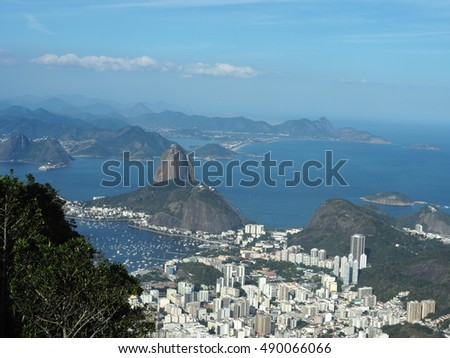 Wonderful view over Rio de Janeiro as viewed from top of Corcovado. The famous Sugar Loaf peak sticks out of Guanabara Bay.