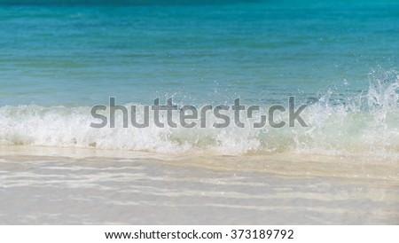 Wonderful water splash at the tropical beach , Located Similan Island,Thailand - stock photo