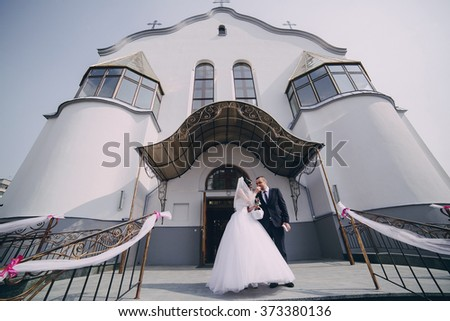 wonderful wedding in the Church, in the summer in the old town - stock photo