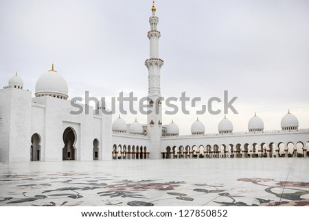 Wonderful white Sheikh Zayed mosque at Abu-Dhabi, UAE on cloudy day. - stock photo