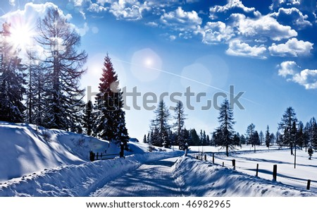 wonderful winter-landscape with blue sky - stock photo