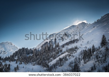 wonderful winter mountain landscape with snow and blue sky - stock photo