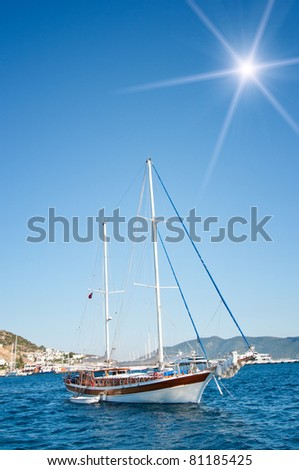 Wonderful yacht in blue bay near Bodrum town.  Turkey. - stock photo