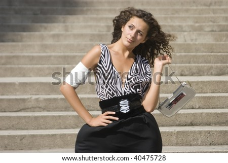 Wondering front of the stairs with medal on her neck