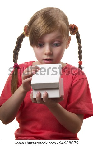 Wondering funny little girl with opened present box isolated over white background - stock photo
