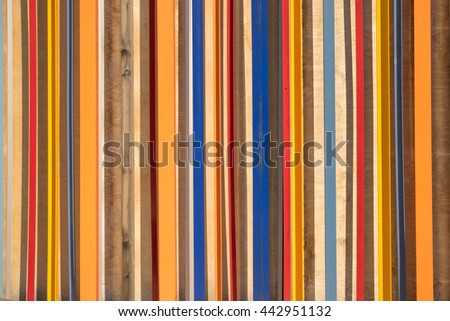 wood and multicoloured striped background