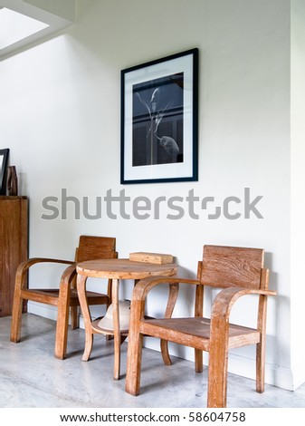 wood armchair in white home interior