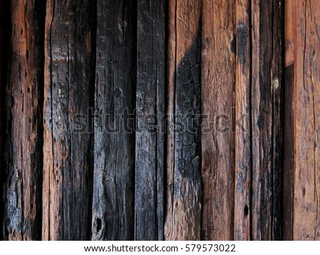 Wood background with bunt from fire