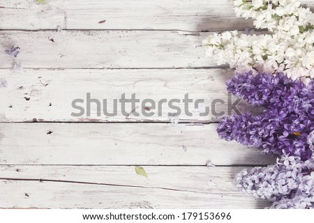 wood background with lilac flowers - stock photo