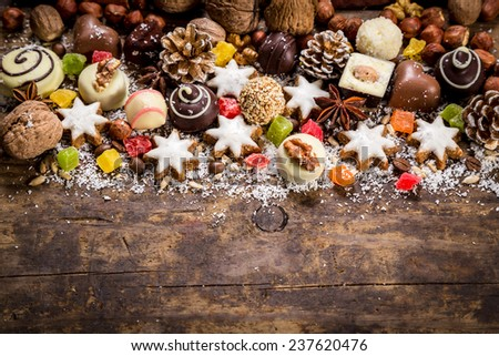 Wood background with sweets, candies, nuts, cookies and dried fruits - stock photo