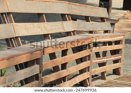 Wood bench on the bridge. - stock photo