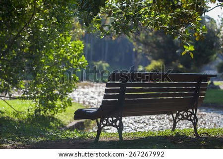 Wood bench with a privilege view of the lake - stock photo