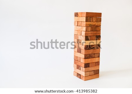 Wood block Stack tower game for children playing on white background - stock photo