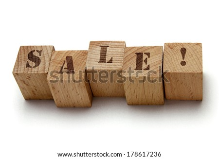 wood blocks with sale word on white background