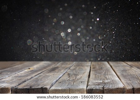 wood board and dark bokeh background. ready for product display - stock photo