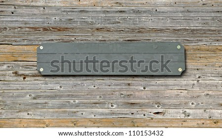 wood board on grunge wood panels - stock photo