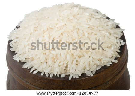 wood bowl of uncooked rice - stock photo
