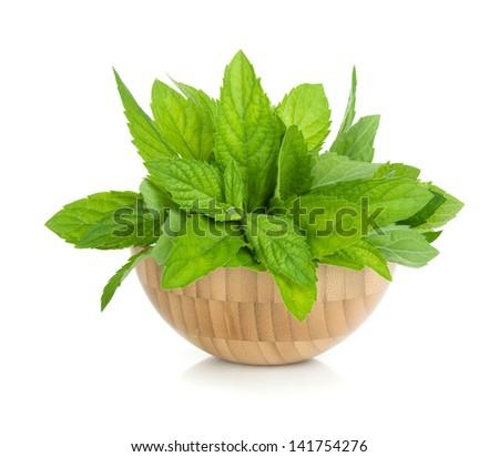 Wood bowl with fresh mint. Isolated on white backround - stock photo