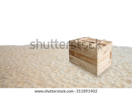 Wood box on sand - stock photo